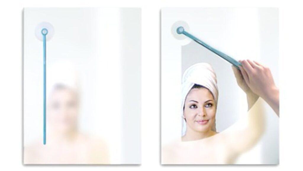 Spegelputsaren. Med denna spegeltorkare (som enkelt fästes på spegeln med sugpropp) drar du bara ett svep och voila, nu har du en klar spegel.